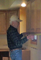 The crew measured each cabinet they removed and installed them in the laundry room and in the new wet bar