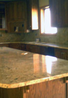 Pix message from home: Alissa sent me a picture of the new granite counter tops!