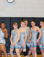 The new championship singlets, modeled by the Varsity wrestlers